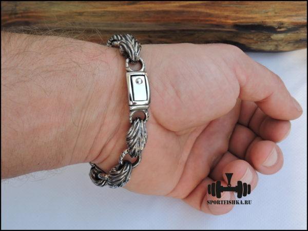Необычный браслет из нержавеющей стали фото на руке