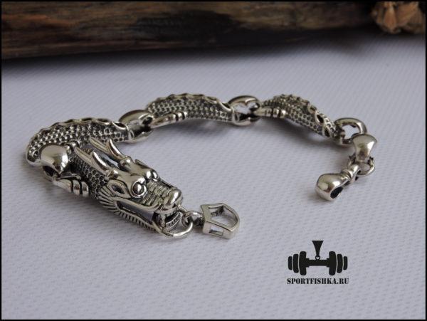 Браслет из серебра с головой дракона картинка